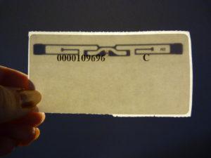 holding RFID label